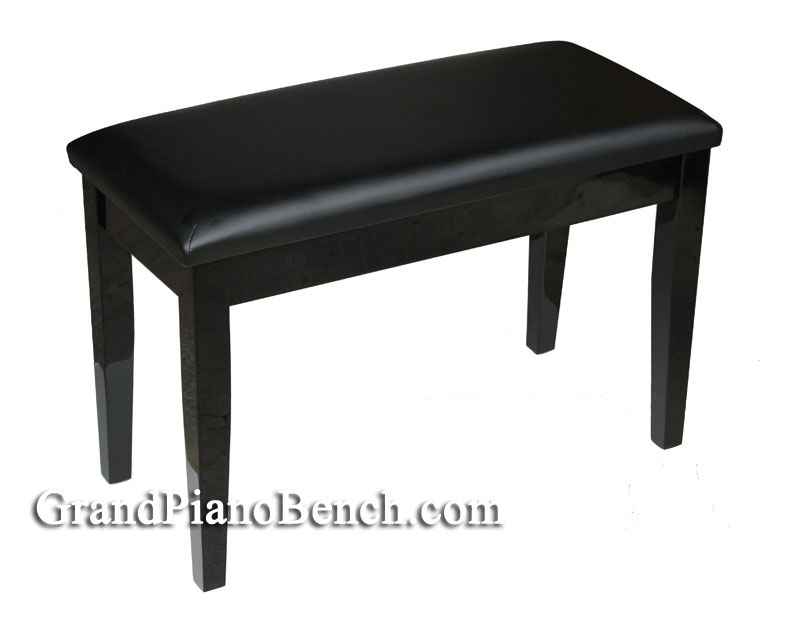 Polished black piano bench with padded top
